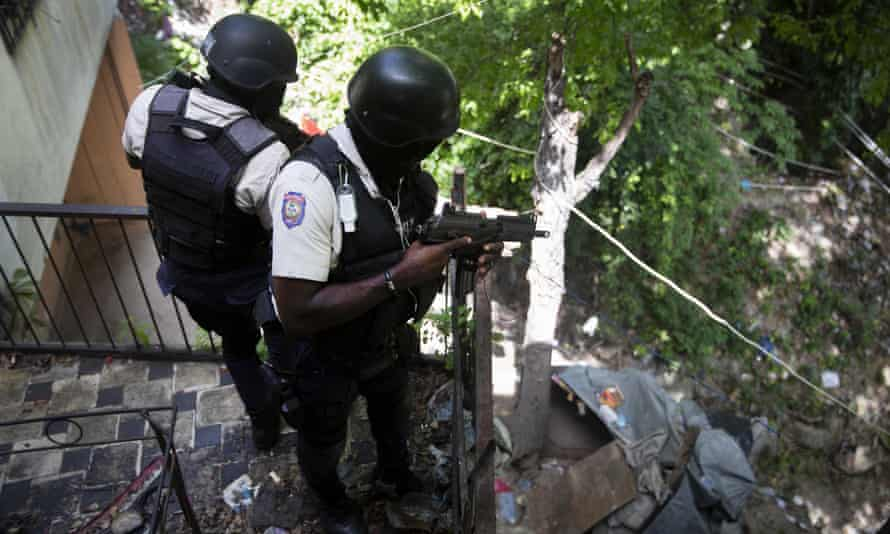 Police search an area of Petion Ville in Port-au-Prince for suspects in the murder of Jovenel Moïse who remain at large.
