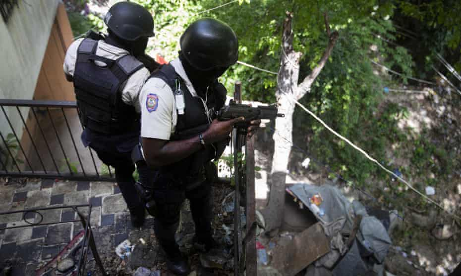 Police search the Morne Calvaire district of Pétion Ville, Haiti, for suspects in the president's murder