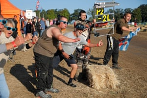 The 12 hour endurance lawn mower race 2018Team members and supporters of the Luxembourg Les' Lux Pussies cheer on their mower as they take the lead five minutes before the end during the 12 hour through the night endurance lawn mower race at Five Oaks near Billingshurst, West Sussex on August 5th 2018 in London (Photo by Tom Jenkins)