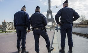 French police officers on patrol at the Trocadero Plaza next to the Eiffel tower
