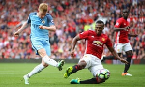 Manchester United's Antonio Valencia tries to block a Kevin De Bruyne shot during last September's derby. The clubs are due to meet this summer in San Diego.