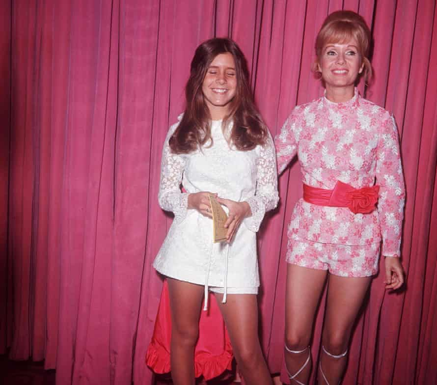 Actor Carrie Fisher with her mother, Debbie Reynolds, in 1972, in front of a pink curtain