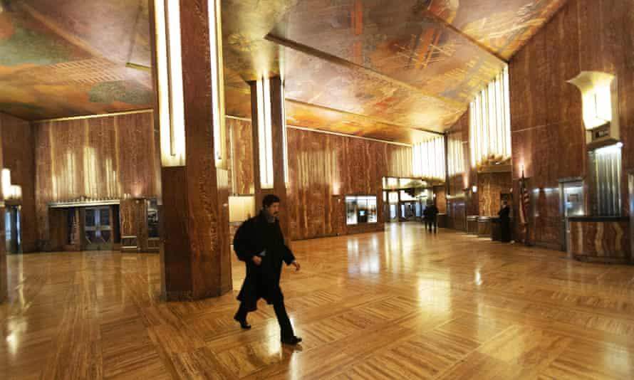 A man walks through the Chrysler building lobby on 9 January.