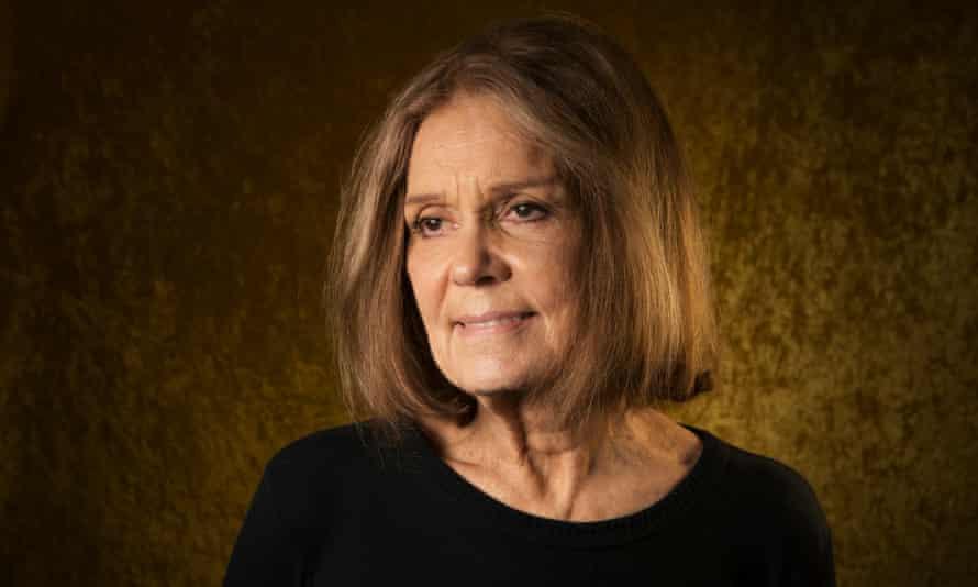 Gloria Steinem, with shoulder-length hair, slightly smiling