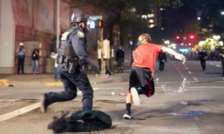 A federal officer attempts to arrest a protester on Tuesday in Portland, Oregon.