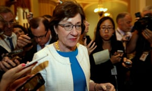 Susan Collins talks to reporters on Capitol Hill.