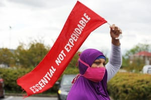 Lanee Jackson of Black Lives Matter DC participates in an 'Essential, Not Expendable' demonstration and rally during the coronavirus pandemic 27 April 2020 in Washington DC.