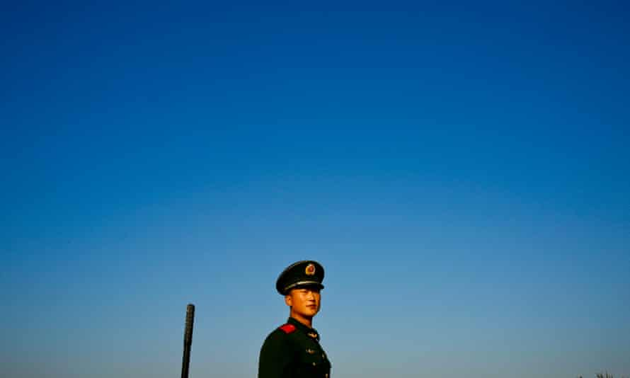 A soldier stands before clear skies in Beijing after new pollution measures were imposed. A huge increase in coal-burning in the last two decades has resulted in serious air pollution.
