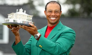 Woods poses in the Green Jacket after completing a glorious victory at Augusta National.