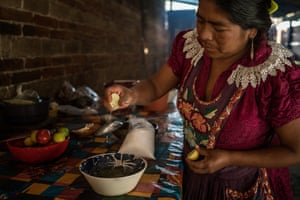 Victoria Santiago Lopez, 35, from San Miguel del Valle in Oaxaca, prepares lunch