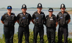 Colin Taylor, centre, with police colleagues on the Isles of Scilly