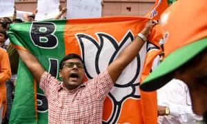A BJP supporter celebrates in Delhi.