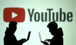 Men in silhouette in front of YouTube's logo