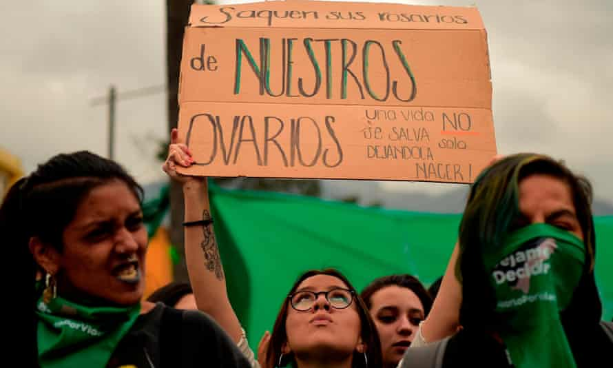 Activists backing the decriminalization of abortion hold a demonstration outside the national assembly building in Quito on Tuesday.