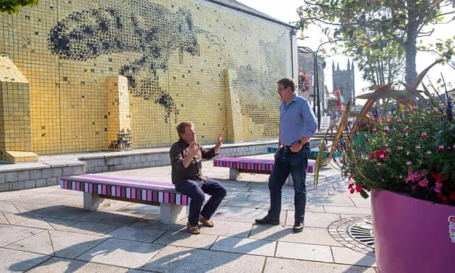Town mayor Richard Pears (right) with curator Alex Murdin by the Cornish Honey Bee mural, part of the Whitegold trail in St Austell, Cornwall.