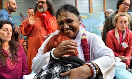 Amma hugs a woman