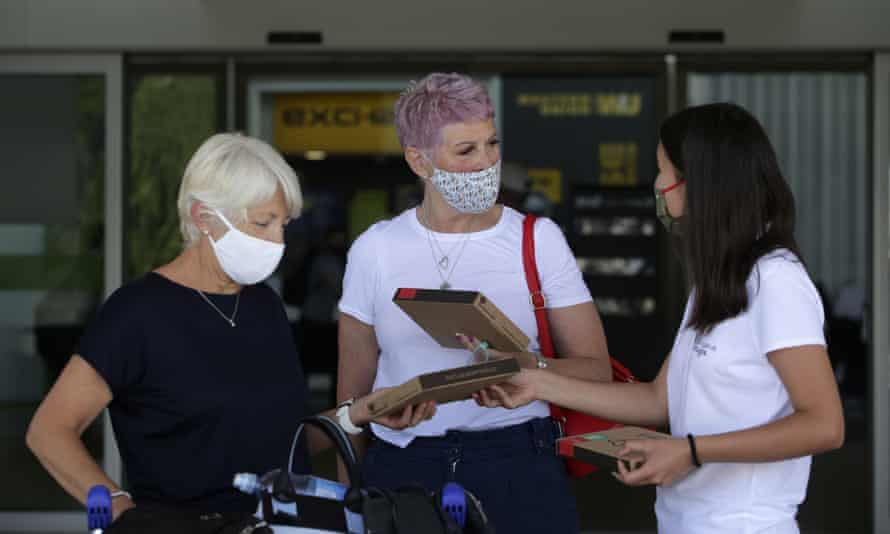 An Algarve tourism authority worker hands out welcome safety kits to passengers from the UK arriving at Faro airport on Monday.