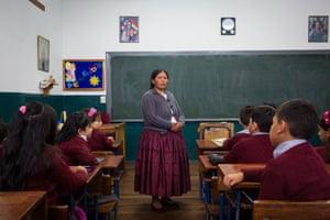 Prof Celia Laura in her classroom in San Calixto private school in La Paz