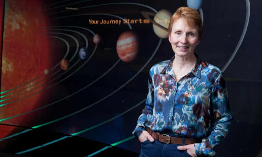 Helen Sharman, Britain's first astronaut, in front of an illustration of the solar system