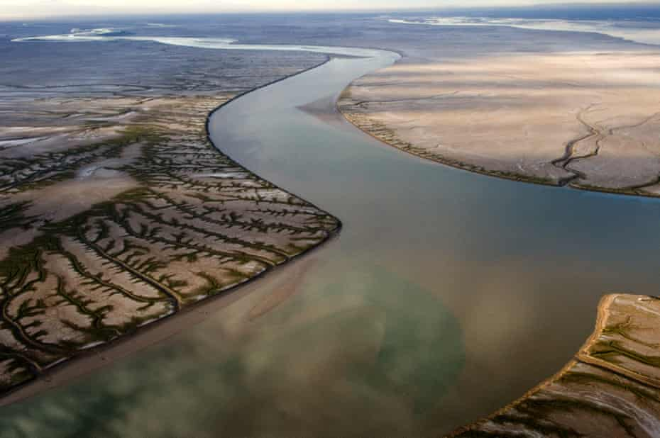Aerial photograph of high tide in the Sea of Cortez flooding the dry Colorado River delta.