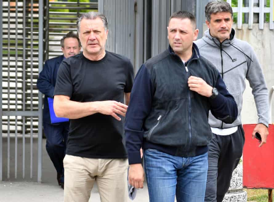 Zdravko Mamic (second right) and his brother Zoran (right) leave the court of Bosnia and Herzegovina after an extradition hearing on 15 June 2018.