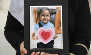 Shelina Begum holds a picture of her five-year-old daughter Tafida Raqeeb.