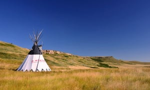 Head Smashed In Buffalo Jump Logo Tipi and cliff