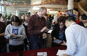 Voters sign in on tablet computers at an early voting location in the Chinatown Plaza, in Las Vegas.