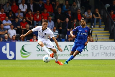 Defender Kane Smith in action for Boreham Wood