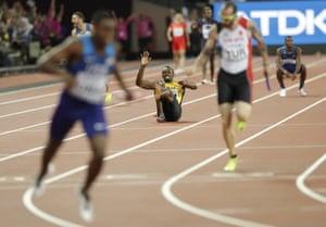 Usain Bolt pulls up injured as Great Britain's Daniel Talbot celebrates.