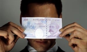 A man with a 20 pound note