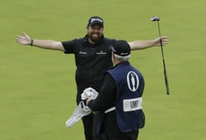 Lowry celebrates with his caddie Bo Martin after winning the British Open.