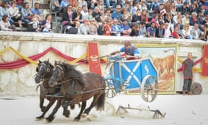 Carted off … a chariot performing stunts in the amphitheatre at NImes, France.
