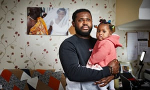 Ernest Boateng with his seven-month-old daughter, Mary. Last week he wrote to the prime minister, urging him to force employers to allow all pregnant women to work from home or be suspended on full pay from 20 weeks .
