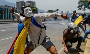 Anti-government protesters clash with security forces in the surroundings of La Carlota military base in Caracas on 1 May after a day of violent clashes on the streets of the capital.