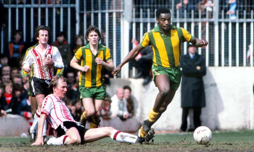 Laurie Cunningham, who emerged at Leyton orient in rthe mid 70s, evades a sliding tackle from Southampton's David Peach while playing for West Brom.