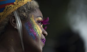A reveler performs during the 'Escravos da Maua' block party as part of pre-Carnival celebrations in Rio de Janeiro, Brazil, on 4 February.