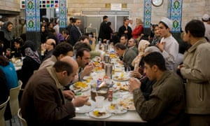 Locals take lunch at a busy restaurant in Tehran.