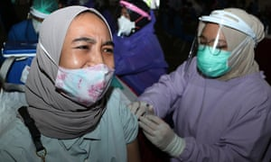 Thousands of residents queued at the UMM Dome building in Malang, a city in the east of Indonesia, for the AstraZeneca Covid-19 vaccine yesterday as part of government efforts to slow down the virus.