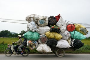 Hanoi, Vietnam A waste collector transports plastic scrap for recycling in the suburbs of the Vietnamese capital