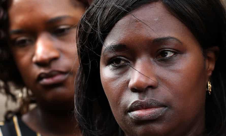 Kadijatu Johnson (right) and Adama Jalloh, the sisters of Sheku Bayoh, speak to the media outside the Crown Office in Edinburgh.