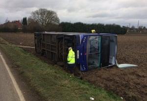 A double decker bus blown onto its side by Storm Doris in Walton Highway near Wisbech, Cambridgeshire