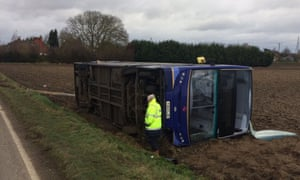 A double decker bus blown on to its side by Storm Doris near Wisbech, Cambridgeshire