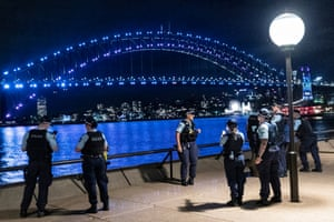 Police patrol at Sydney Opera House during New Year's Eve celebrations. This years fireworks display has been shortened to seven minutes, with numerous other restrictions in place