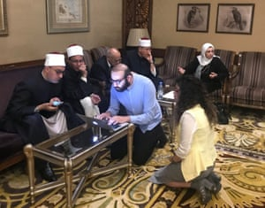 Aya Chebbi and Abdalaziz Alhamza with the deputy grand imam of al-Azhar, second from left, and his team