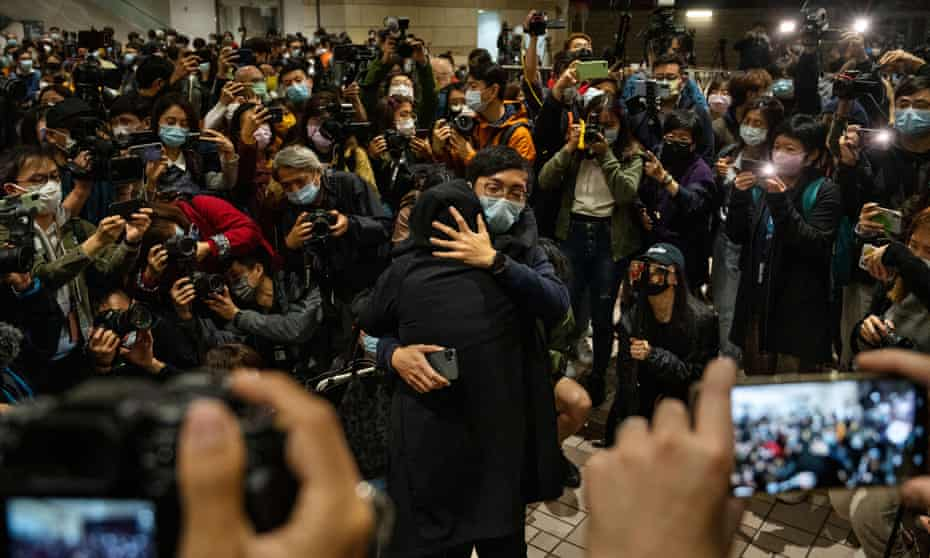 Supporters comfort each other after hearing bail results at West Kowloon Court in Hong Kong