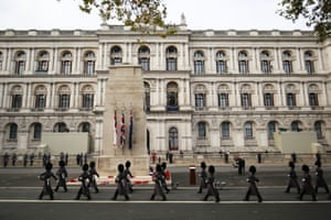 Members of the armed forces march past the Cenotaph during the Remembrance Sunday service in Whitehall, London
