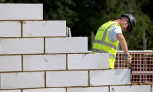 A bricklayer on a building site. Over the past year, almost three in four new jobs went to foreign nationals.