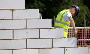 A construction worker at work on a Crest Nicholson housing development.