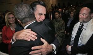 Mitt Romney, center, hugs Rev. Jeffrey Brown of Boston, as David Nierenberg looks on, Thursday, 6 December, 2007.